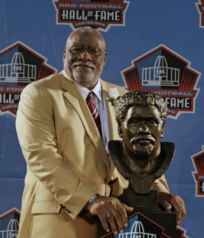 Hall of Fame Inductee Claude Humphrey poses with his bust during the 2014 Pro Football Hall of Fame Enshrinement Ceremony at the Pro Football Hall of Fame Saturday, Aug. 2, 2014, in Canton, Ohio. Photo: Tony Dejak, Associated Press