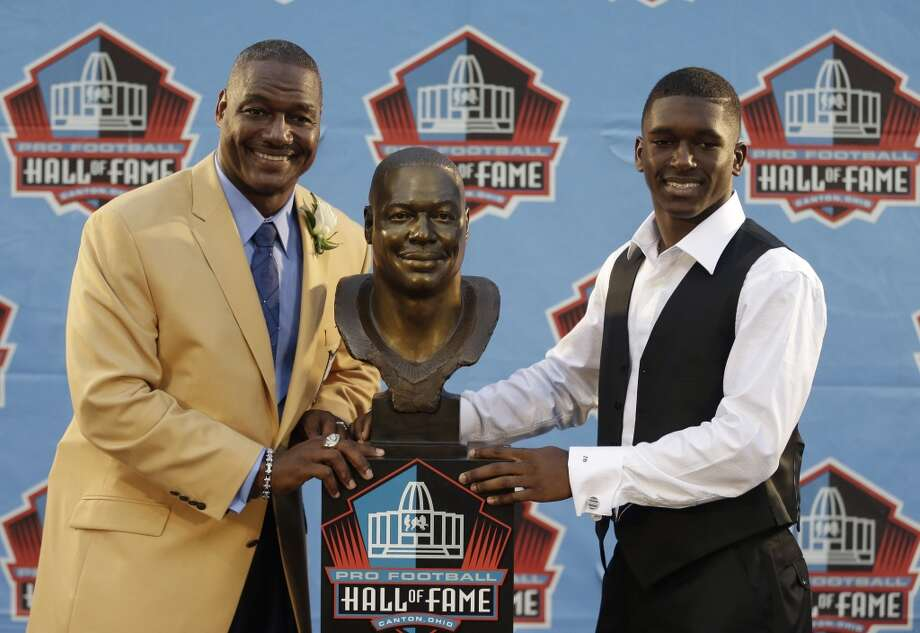 Hall of Fame Inductee Derrick Brooks, left, with his son, presenter Decalon Brooks, pose with the bust during the 2014 Pro Football Hall of Fame Enshrinement Ceremony at the Pro Football Hall of Fame Saturday, Aug. 2, 2014, in Canton, Ohio. Photo: Tony Dejak, Associated Press