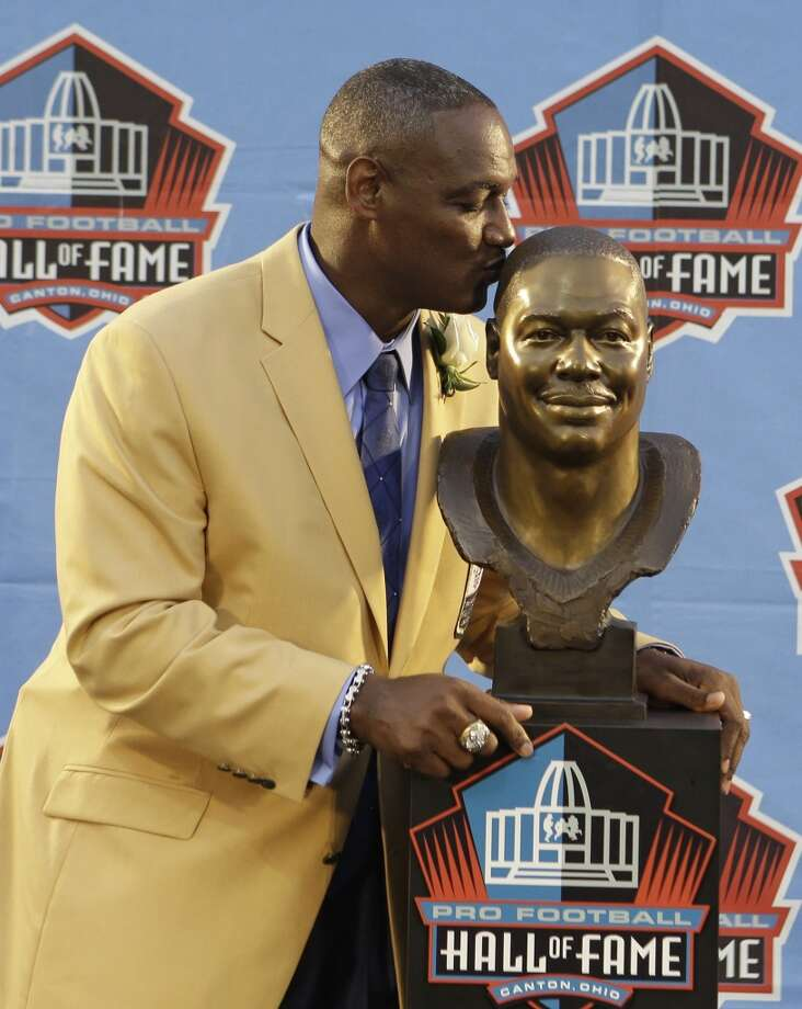 Hall of Fame Inductee Derrick Brooks kisses his bust during the 2014 Pro Football Hall of Fame Enshrinement Ceremony at the Pro Football Hall of Fame Saturday, Aug. 2, 2014, in Canton, Ohio. Photo: Tony Dejak, Associated Press