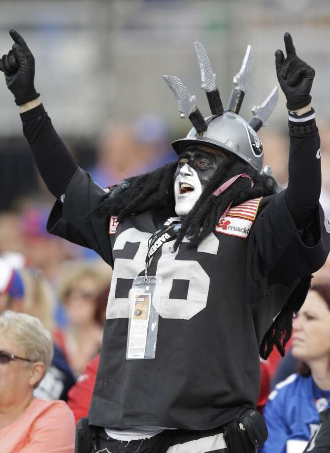 An Oakland Raiders fan cheers during the 2014 Pro Football Hall of Fame Enshrinement Ceremony at the Pro Football Hall of Fame Saturday, Aug. 2, 2014, in Canton, Ohio. Photo: Tony Dejak, Associated Press