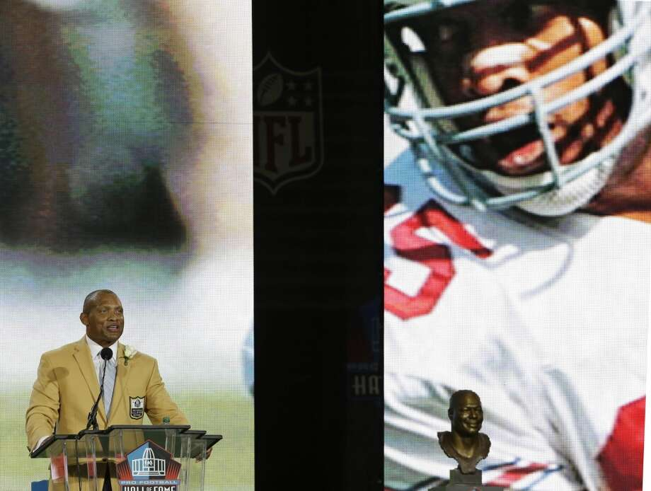 Hall of Fame inductee Aeneas Williams speaks during the Pro Football Hall of Fame enshrinement ceremony Saturday, Aug. 2, 2014, in Canton, Ohio. Photo: Tony Dejak, Associated Press