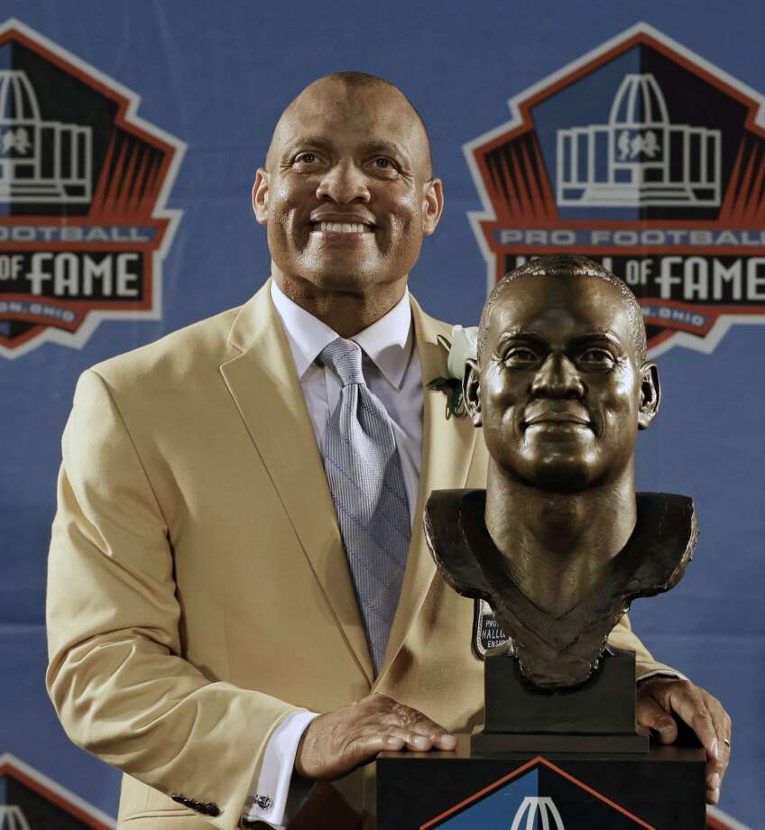 Hall of Fame inductee Aeneas Williams poses with his bust during the 2014 Pro Football Hall of Fame Enshrinement Ceremony at the Pro Football Hall of Fame Saturday, Aug. 2, 2014, in Canton, Ohio. Photo: Tony Dejak, Associated Press