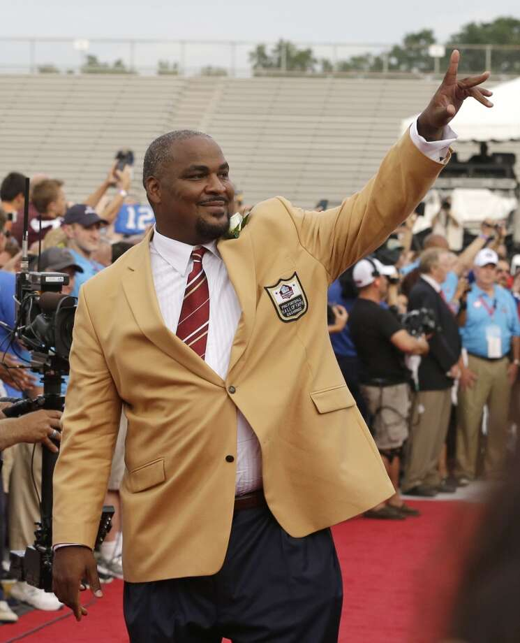 Hall of Fame Inductee Walter Jones waves to fans as he is introduced during the 2014 Pro Football Hall of Fame Enshrinement Ceremony at the Pro Football Hall of Fame Saturday, Aug. 2, 2014, in Canton, Ohio. Photo: Tony Dejak, Associated Press