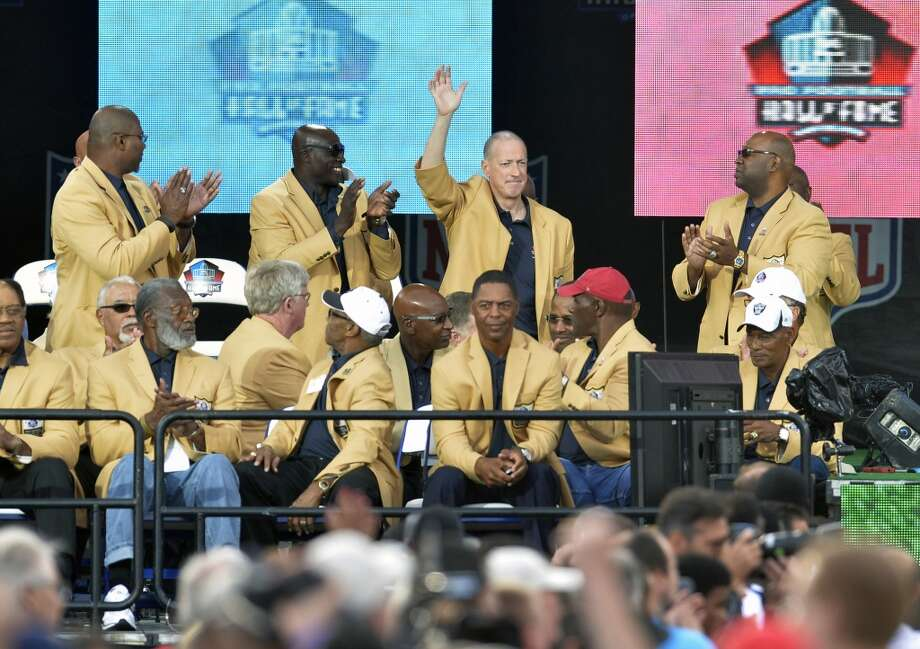 Former Buffalo Bills quarterback Jim Kelly waves to the crowd during the 2014 Pro Football Hall of Fame Enshrinement Ceremony at the Pro Football Hall of Fame Saturday, Aug 2, 2014 in Canton, Ohio. Photo: David Richard, Associated Press