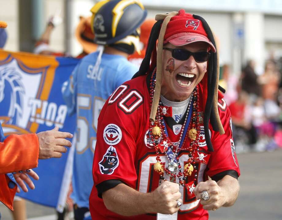Mark Goodman, a member of the Pro Football Ultimate Fan Association, has fun pumping up the crowd along the parade route during the Timkensteel Grand Parade in downtown Canton, Ohio, on Saturday, Aug 2, 2014. The parade is part of weekend festivities surrounding the induction of the 2014 class to the Pro Football Hall of Fame. Photo: Dirk Shadd, McClatchy-Tribune News Service