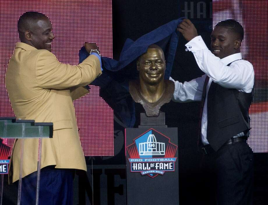 Tampa Bay Buccaneers linebacker Derrick Brooks and his presenter, son Decalon Brooks, 15, unveil the bust during the Hall of Fame Enshrinement Ceremony in Canton, Ohio, on Saturday, Aug. 2, 2014. Photo: Dirk Shadd, McClatchy-Tribune News Service