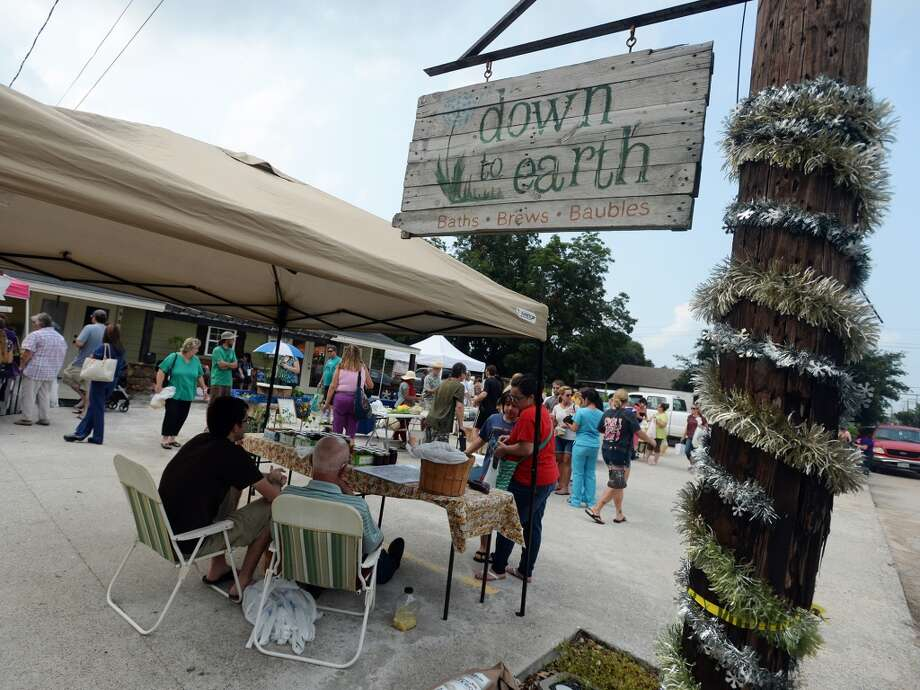 People peruse the Down to Earth market on Tuesday. Down to Earth, a Nederland shop that specializes in locally produced natural and organic items, has launched a Tuesday afternoon farmers market in their parking lot. Photo taken Tuesday 7/22/14 Jake Daniels/@JakeD_in_SETX