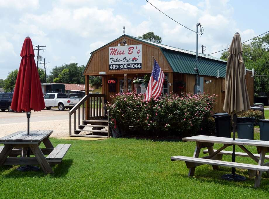 Picnic tables and trash cans sit outside Miss B's on Monday afternoon. Miss B's Take Out in Port Arthur is the Cat5 Restaurant of the Week for July 31, 2014.  Photo taken Monday 7/21/14 Jake Daniels/@JakeD_in_SETX