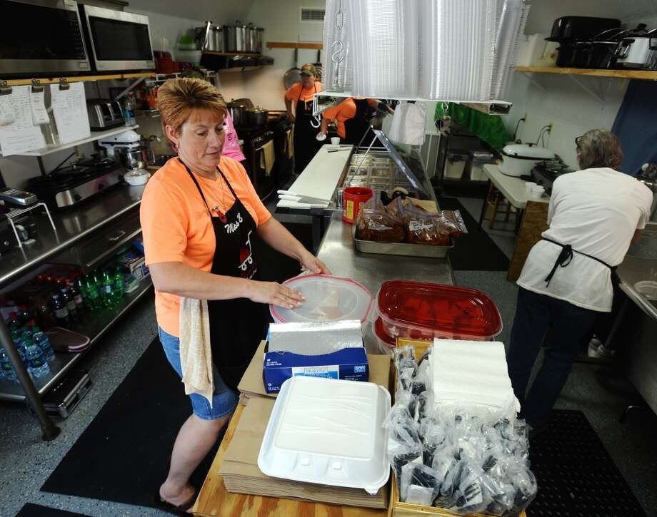 Barbara Johnson, left, and others work in the kitchen of Miss B's on Monday afternoon. Miss B's Take Out in Port Arthur is the Cat5 Restaurant of the Week for July 31, 2014.  Photo taken Monday 7/21/14 Jake Daniels/@JakeD_in_SETX