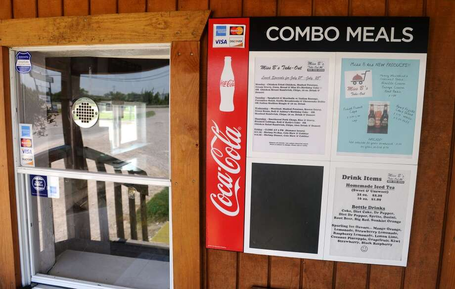 Menus are attached to the wall outside the ordering window at Miss B's on Monday afternoon. Miss B's Take Out in Port Arthur is the Cat5 Restaurant of the Week for July 31, 2014.  Photo taken Monday 7/21/14 Jake Daniels/@JakeD_in_SETX