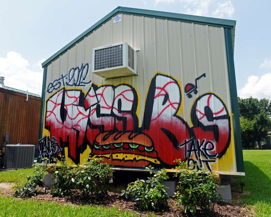 A commissioned mural by artist Beck Cole decorates the side of a building at Miss B's on Monday afternoon. The mural is a new addition to the restaurant. Miss B's Take Out in Port Arthur is the Cat5 Restaurant of the Week for July 31, 2014.  Photo taken Monday 7/21/14 Jake Daniels/@JakeD_in_SETX