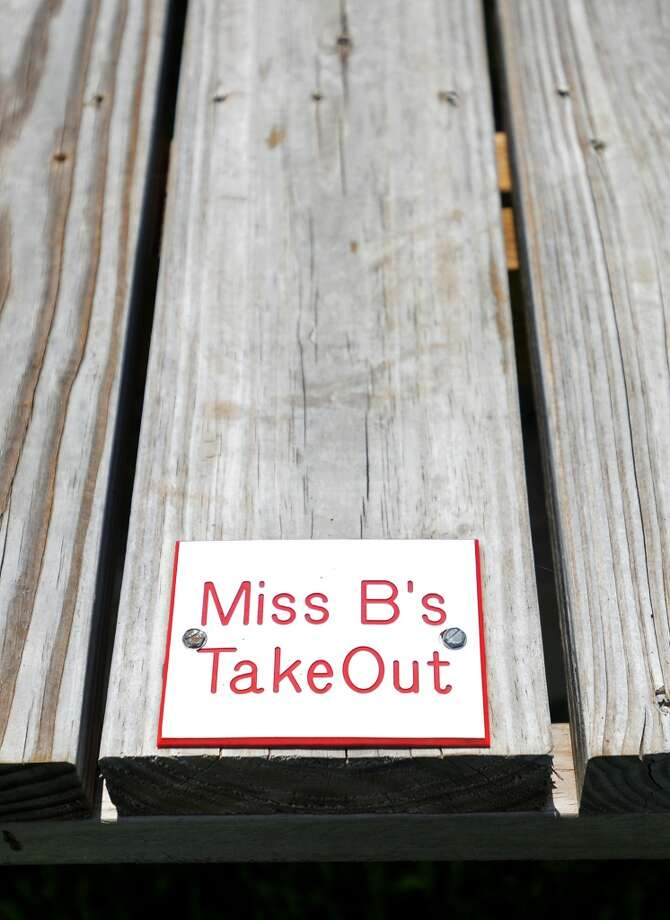 A small plaque designates a picnic table as property of Miss B's. Miss B's Take Out in Port Arthur is the Cat5 Restaurant of the Week for July 31, 2014.  Photo taken Monday 7/21/14 Jake Daniels/@JakeD_in_SETX