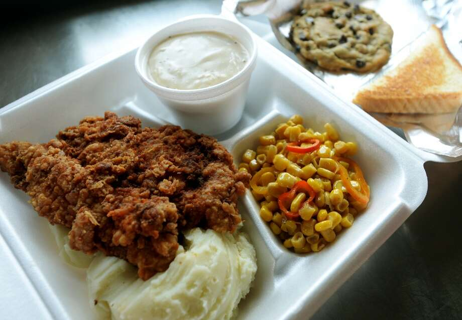 Pictured is the Monday lunch plate of chicken-fried chicken, mashed potatoes, gravy, corn, toast and a chocolate chip cookie. Miss B's Take Out in Port Arthur is the Cat5 Restaurant of the Week for July 31, 2014.  Photo taken Monday 7/21/14 Jake Daniels/@JakeD_in_SETX