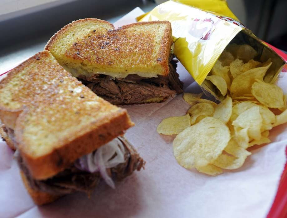 Pictured is the brisket provolone sandwich with a bag of chips from Miss B's. Miss B's Take Out in Port Arthur is the Cat5 Restaurant of the Week for July 31, 2014.  Photo taken Monday 7/21/14 Jake Daniels/@JakeD_in_SETX