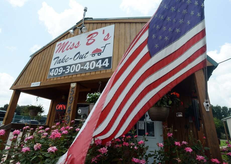An American flag waves in front of Miss B's Take Out on Monday afternoon. Miss B's Take Out in Port Arthur is the Cat5 Restaurant of the Week for July 31, 2014.  Photo taken Monday 7/21/14 Jake Daniels/@JakeD_in_SETX