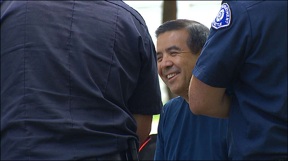 Robb Montejano is tended to by emergency personnel after getting struck by lightning Saturday in Seattle's Green Lake neighborhood. He was recording video with his phone, hoping to get a shot of a lightning bolt, when he was struck. Photo: KOMO-TV Photo