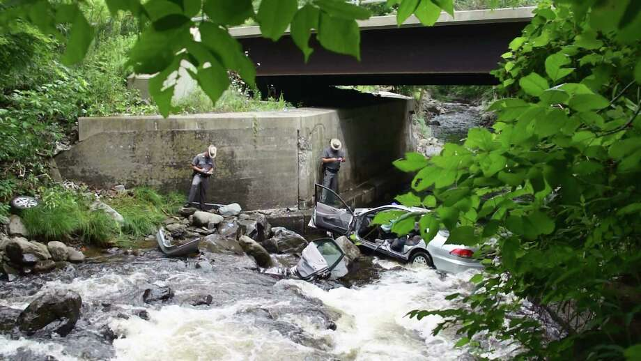 Scene of fatal accident involving a car over a bridge on Route 2 in Brunswick Sunday, Aug. 3, 2014. (Photograph courtsey of Marty Miller)