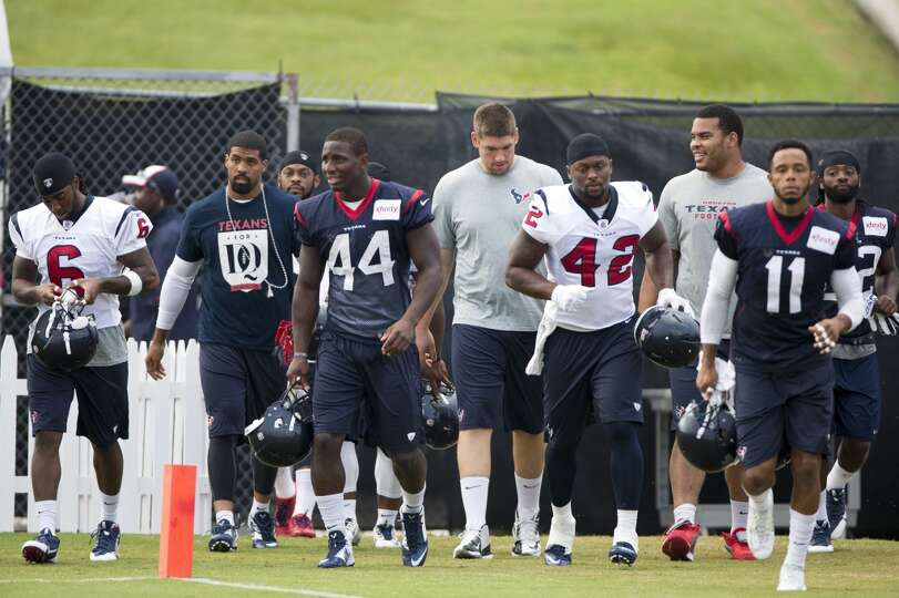 Texans players arrive for practice.