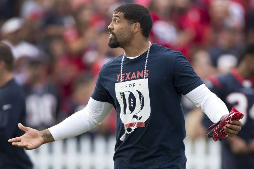 Arian Foster walks onto the practice field.