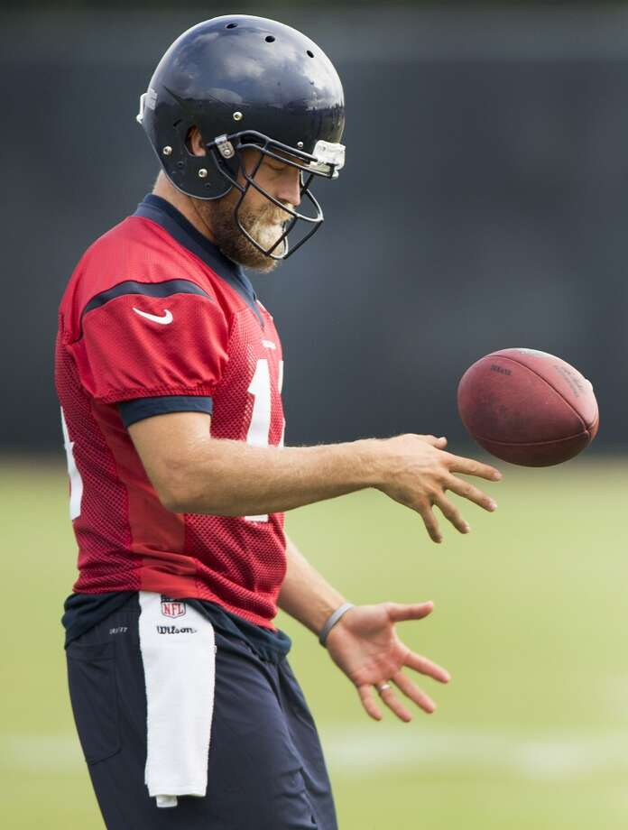Quarterback Ryan Fitzpatrick flips a football in the air. Photo: Brett Coomer, Houston Chronicle