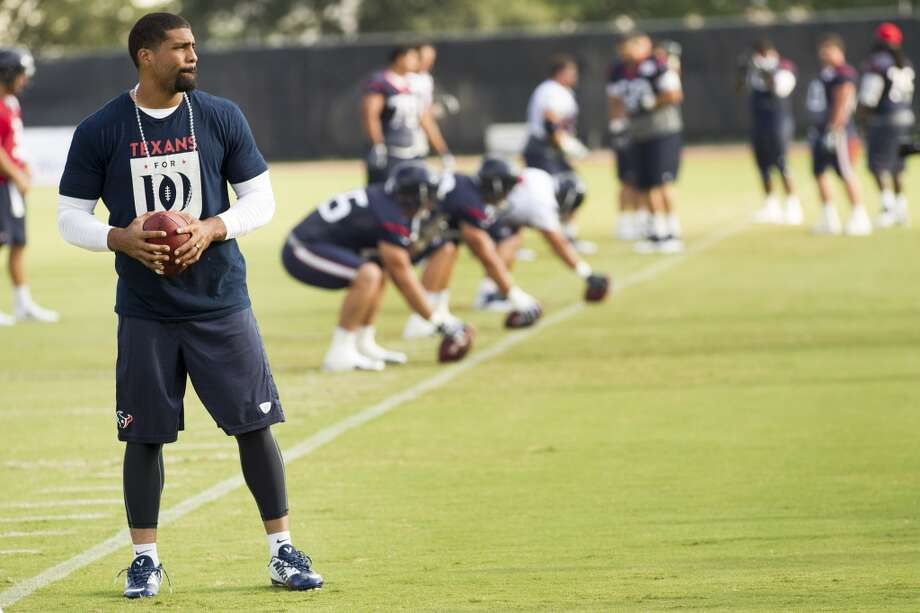 Running back Arian Foster stands on the practice field. Photo: Brett Coomer, Houston Chronicle
