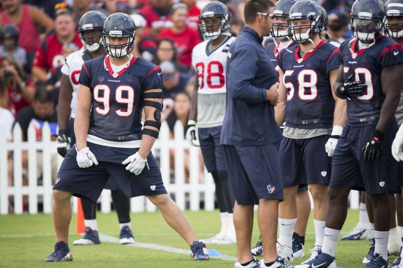Defensive end J.J. Watt (99) lines up for stretching.