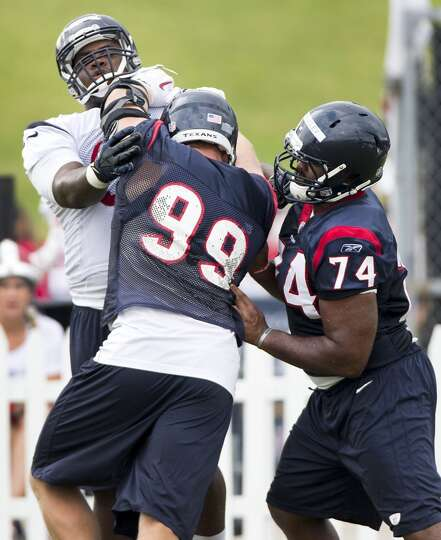 Texans defensive end J.J. Watt (99) goes up against defensive ends Jeoffrey Pagan (97) and Julius Wa