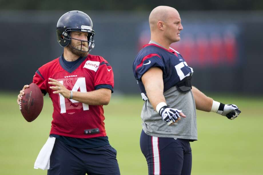 Day 8: August 3   Texans quarterback Ryan Fitzpatrick (14) and  center Chris Myers (55) get ready for practice. Photo: Brett Coomer, Houston Chronicle