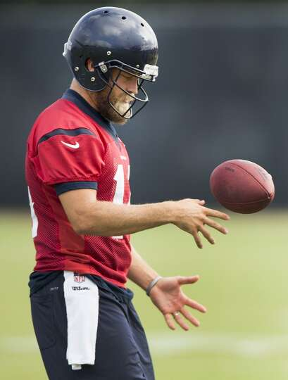 Quarterback Ryan Fitzpatrick flips a football in the air.