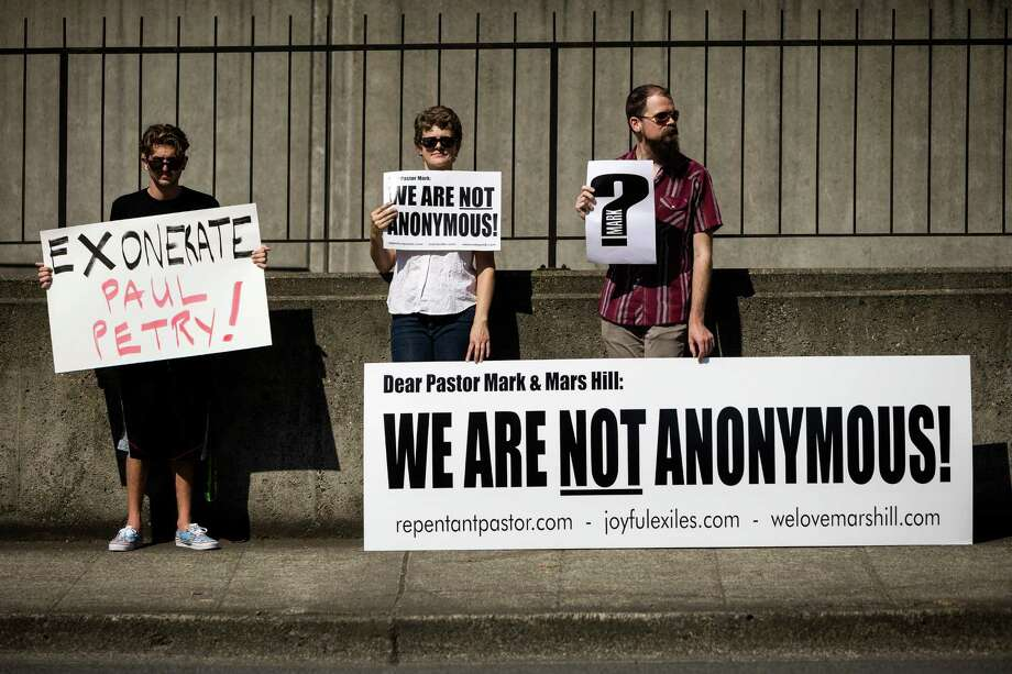 "Toting signs claiming ""We Are Not Anonymous,"" former members of the Seattle-based Mars Hill Church gather at a self-titled ""Peaceful Protest"" Sunday, August 3, 2014, at the church's main site in Bellevue, Wash. The protest came about in regards to Mark Driscoll, pastor of Mars Hill Church, claiming he was confused as to how to reconcile with people who were 'hurt' by his actions because they are 'anonymous.' Photo: JORDAN STEAD, SEATTLEPI.COM / SEATTLEPI.COM"