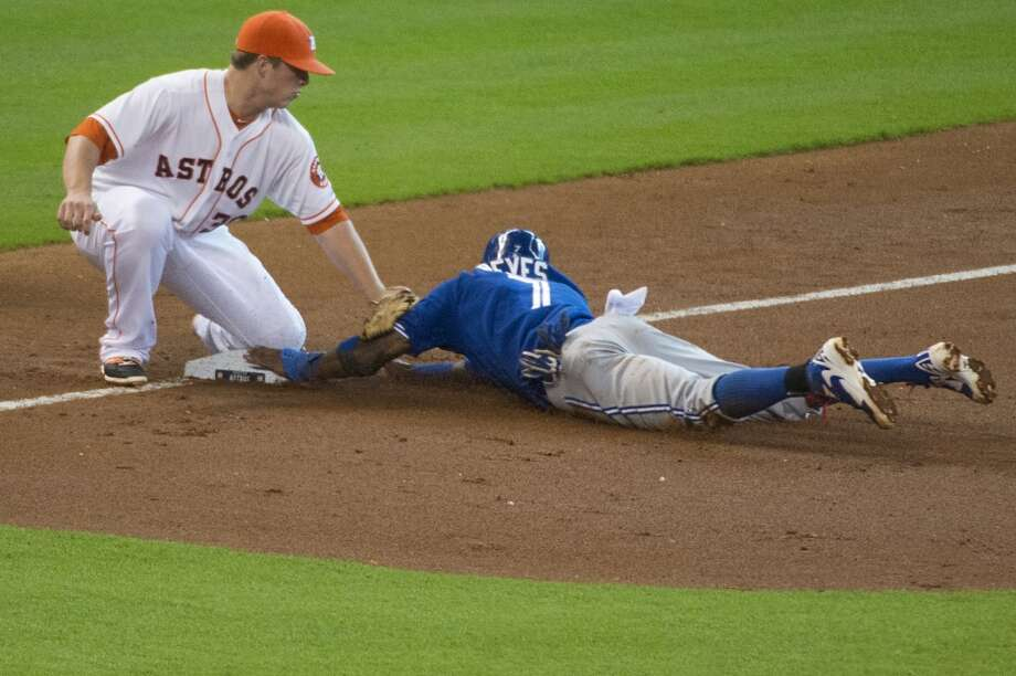 Blue Jays shortstop Jose Reyes is safe with a stolen base as Astros third baseman Matt Dominguez applies the tag during the third inning. Photo: Smiley N. Pool, Houston Chronicle