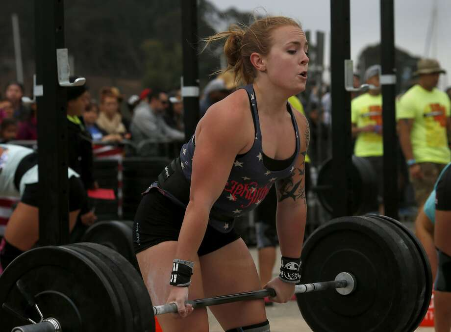 Marin County's Kate Brierley made a lift during the competition Sunday August 3, 20914. LaLanne Fitness CrossFit hosted the 4th annual Summer Throwdown, the pinnacle of CrossFit competitions in Northern California, on Treasure Island where 300 elite athletes did battle for the fittest in Northern California. Photo: Brant Ward, San Francisco Chronicle