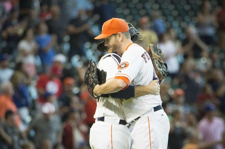 Houston Astros starting pitcher Scott Feldman celebrates with catcher Jason Castro after the final out against the Toronto Blue Jays at Minute Maid Park on Sunday, Aug. 3, 2014, in Houston. Feldman pitched a complete game in the Astros 6-1 victory. ( Smiley N. Pool / Houston Chronicle ) Photo: Smiley N. Pool, Houston Chronicle