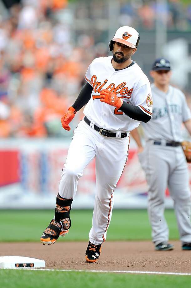 Baltimore's Nick Markakis rounds third base after hitting a leadoff home run in the first inning. Photo: Greg Fiume, Getty Images
