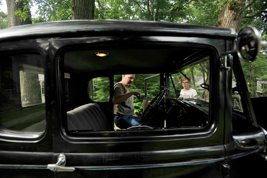 Ken Byrne works on his 1930 Ford Model A with his daughter, Maura Byrne, in their driveway in Stamford, Conn., on Sunday, Aug. 3, 2014. Ken originally got the antique to work on as a joint project with his father four years ago and continues his work on it with his daughter as well. Photo: Jason Rearick / Stamford Advocate