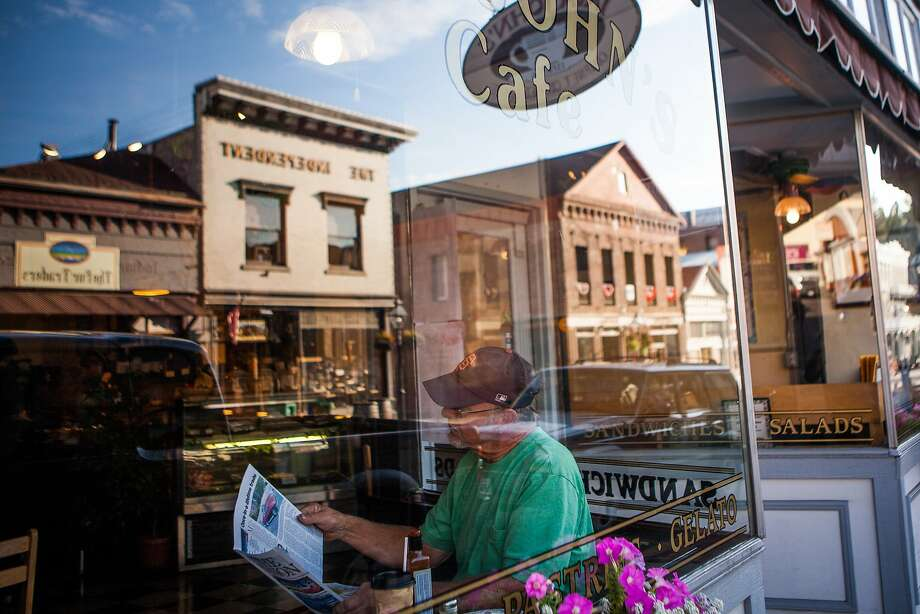 Don Murphy reads a newspaper over breakfast at Java John's Cafe in downtown Nevada City. A long, involved fraud case is straining the resources of Nevada County, which has fewer than 100,000 residents. Photo: Max Whittaker/Prime, Special To The Chronicle