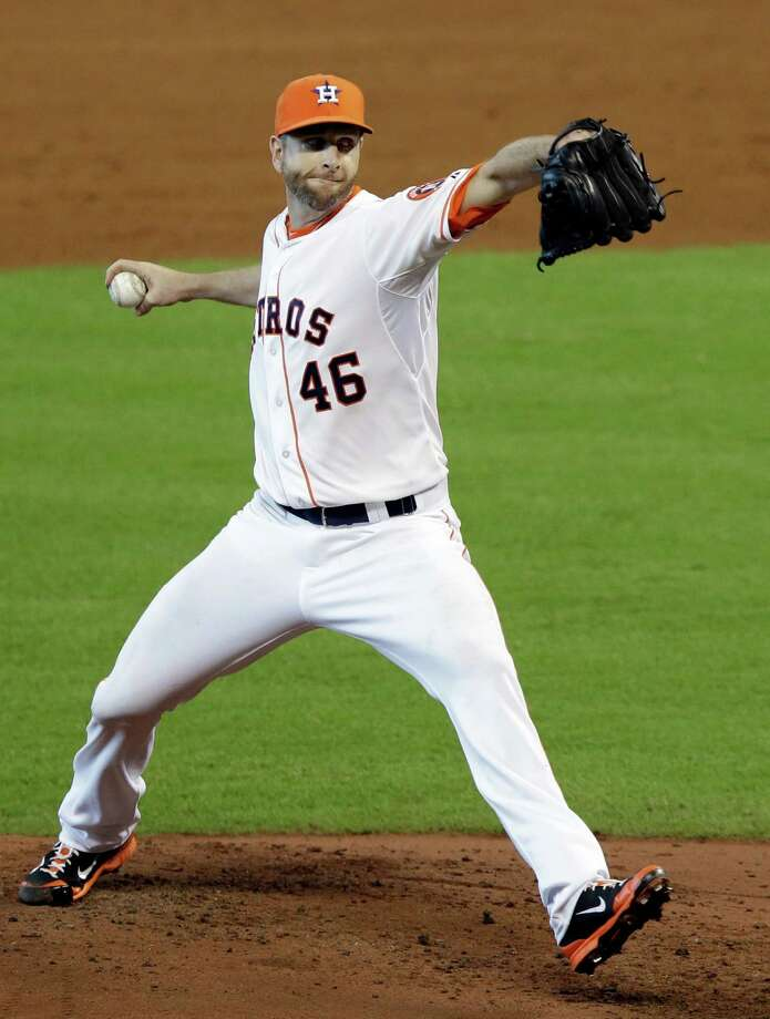 Houston Astros starter Scott Feldman delivers a pitch against the Toronto Blue Jays in the fifth inning of a baseball game, Sunday, Aug. 3, 2014, in Houston. (AP Photo/Pat Sullivan) Photo: Pat Sullivan, Associated Press / AP