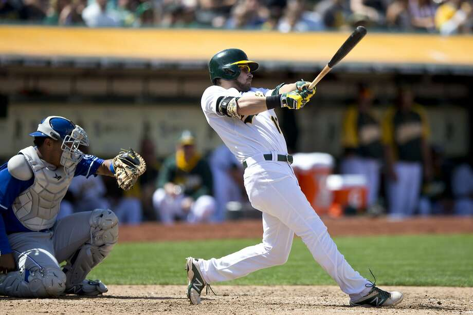 OAKLAND, CA - AUGUST 03:  Josh Reddick #16 of the Oakland Athletics hits a home run against the Kansas City Royals during the eighth inning at O.co Coliseum on August 3, 2014 in Oakland, California. (Photo by Jason O. Watson/Getty Images) Photo: Jason O. Watson, Getty Images