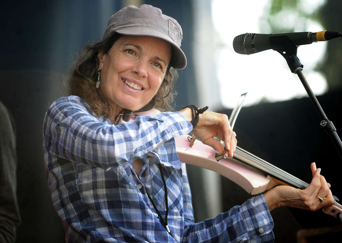 Multi-instrumentalist and vocalist Tara Nevins performs with her band, Donna the Buffalo, on the Green Vibes Stage at the 19th annual Gathering of the Vibes Musical Festival at Seaside Park in Bridgeport, Conn. on Sunday, August 3, 2014.