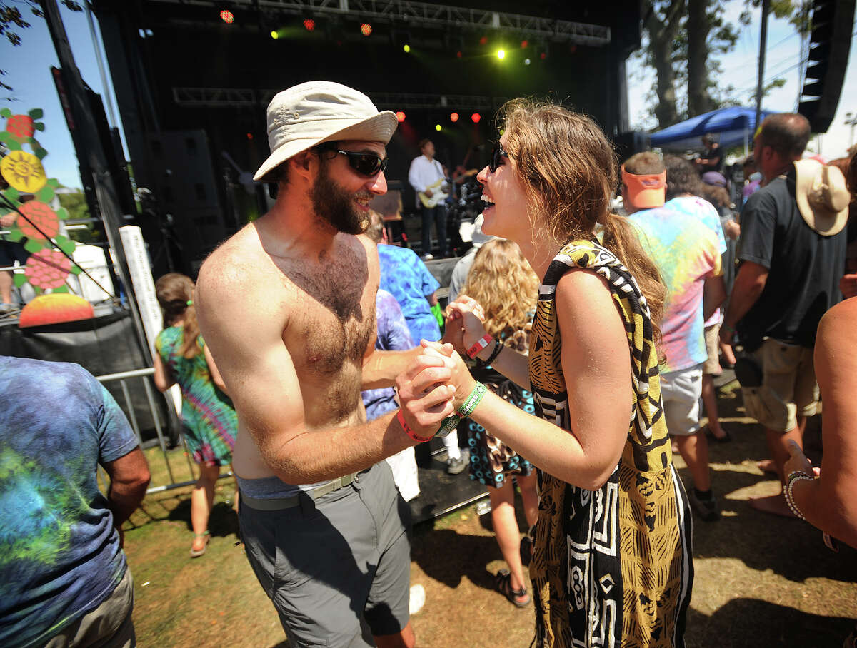 Jacob Sellers and Rebecca Marshburn, both of Savannah, Georgia dance to the music of Donna the Buffalo, playing on the Green Vibes Stage at the 19th annual Gathering of the Vibes Musical Festival at Seaside Park in Bridgeport, Conn. on Sunday, August 3, 2014.
