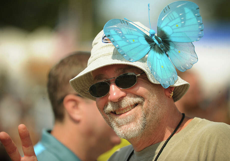 Shawn Hogan of West Milford, NJ, adorns his hat with a large butterfly at the 19th annual Gathering of the Vibes Musical Festival at Seaside Park in Bridgeport, Conn. on Sunday, August 3, 2014. Photo: Brian A. Pounds / Connecticut Post freelance