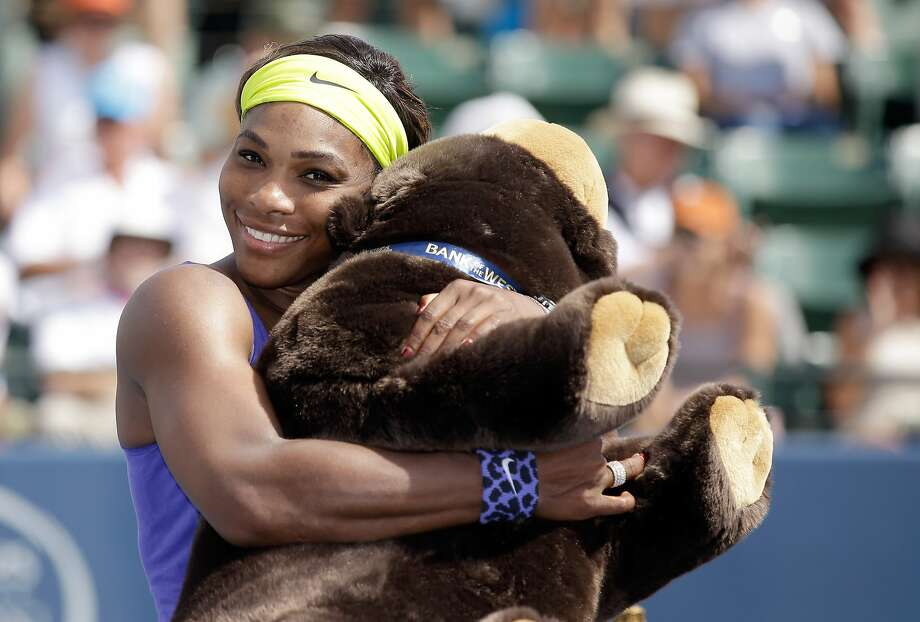Serena Williams hugs a stuffed bear after embracing the challenge of a big first-set deficit against Angelique Kerber. Photo: Ezra Shaw, Getty Images