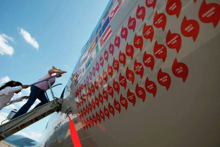 Students from Dickinson board a Lockheed WP-3D Orion hurricane hunter airplane for a tour at Scholes Field in Galveston in 2008. Stickers on the plane signify how many hurricanes the plane has flown into. Photo: Nick De La Torre, Staff / Houston Chronicle