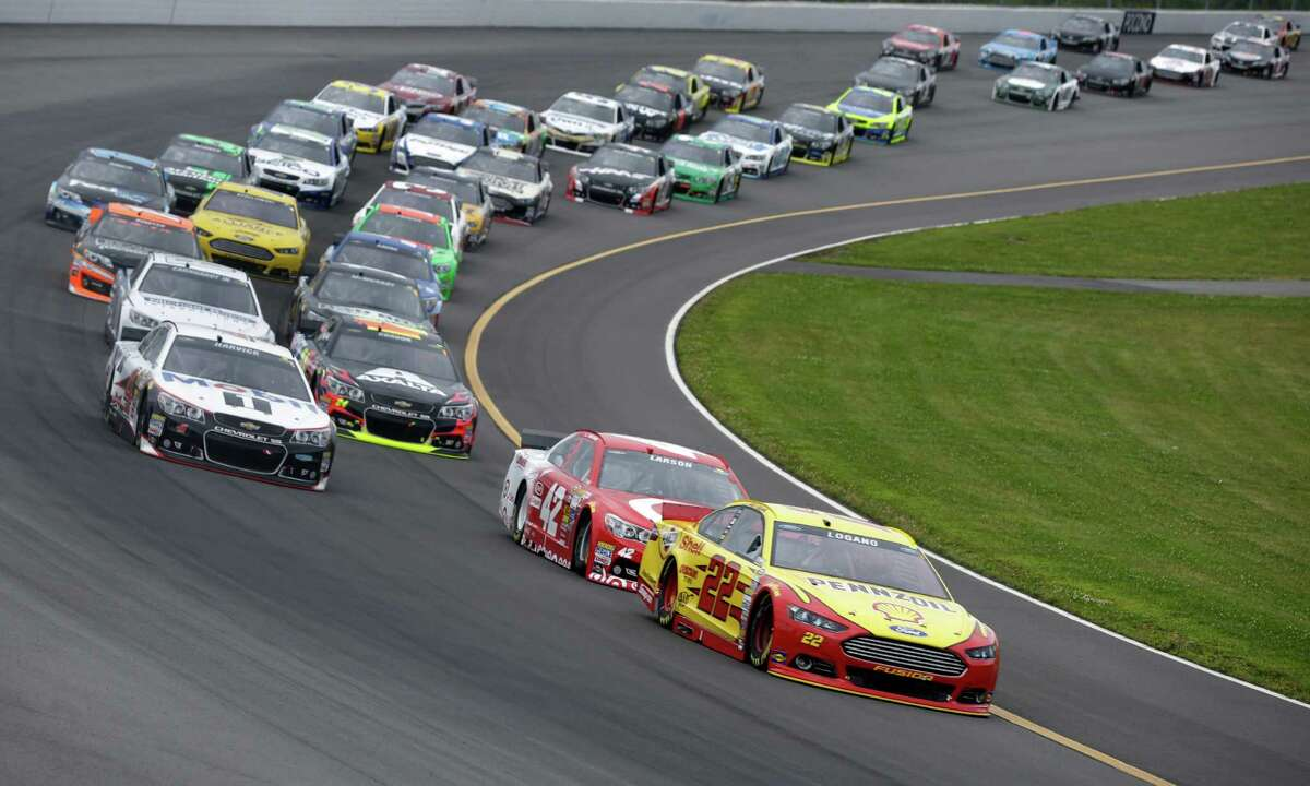 Joey Logano (22) leads Kyle Larson (42) on an early restart during the NASCAR Sprint Cup Series auto race at Pocono Raceway, Sunday, Aug. 3, 2014, Long Pond, Pa. (AP Photo/Mel Evans) ORG XMIT: PAME104