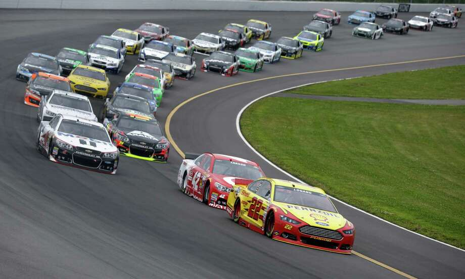 Joey Logano (22) leads Kyle Larson (42) on an early restart during the NASCAR Sprint Cup Series auto race at Pocono Raceway, Sunday, Aug. 3, 2014, Long Pond, Pa. (AP Photo/Mel Evans)   ORG XMIT: PAME104 Photo: Mel Evans / AP
