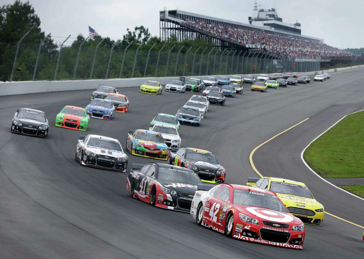 Kyle Larson (42) leads a pack of cars at the start of the NASCAR Sprint Cup Series auto race at Pocono Raceway, Sunday, Aug. 3, 2014, Long Pond, Pa. (AP Photo/Mel Evans) ORG XMIT: PAME103