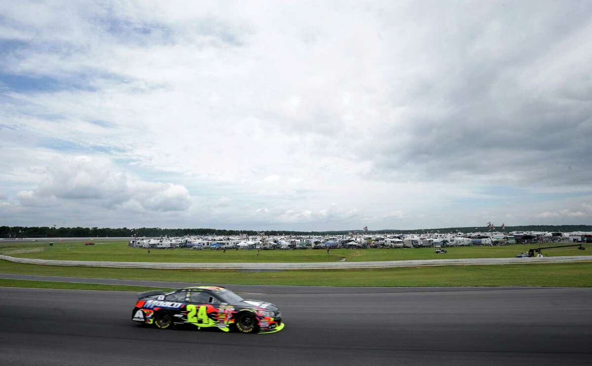 Jeff Gordon (24) drives out of Turn 3 during the NASCAR Sprint Cup Series auto race at Pocono Raceway, Sunday, Aug. 3, 2014, Long Pond, Pa. (AP Photo/Mel Evans) ORG XMIT: PAME106