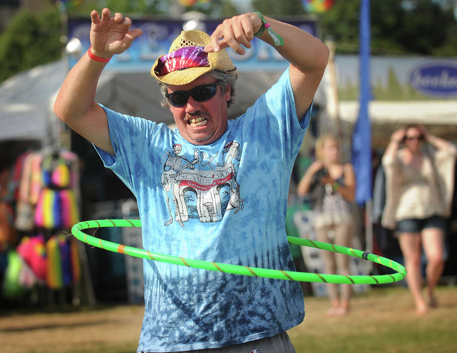 Brook Dorflinder, of Bridgeport, gives the hula hoop a try at the 19th annual Gathering of the Vibes Musical Festival at Seaside Park in Bridgeport, Conn. on Sunday, August 3, 2014. Photo: Brian A. Pounds / Connecticut Post freelance