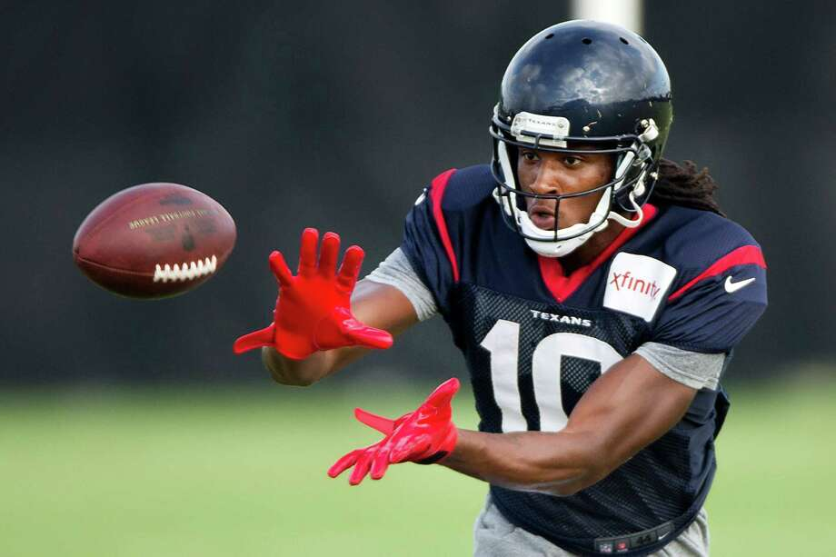 Always able to make spectacular plays, wide receiver DeAndre Hopkins is concentrating on being consistent in order to avoid the valleys that were part of an up-and-down rookie season. Photo: Brett Coomer, Staff / © 2014 Houston Chronicle