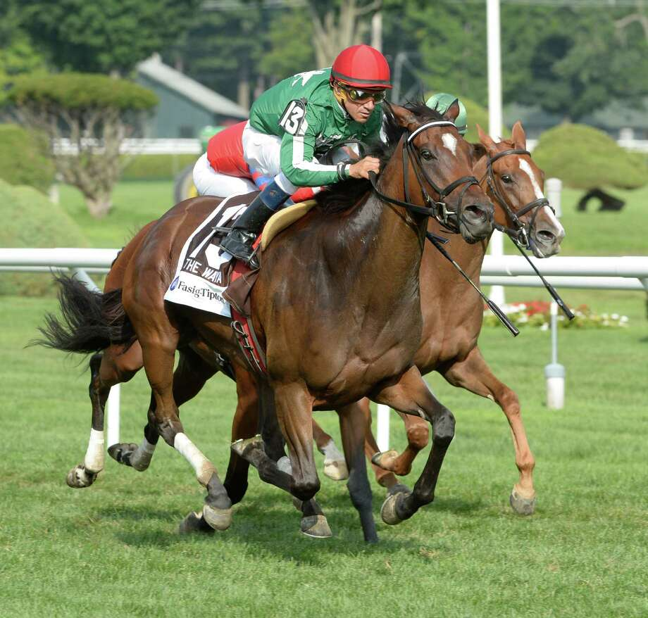 Cat's Claw ridden by jockey Cornelio Velasquez powers past the field to win the 11th running of The Fasig-Tipton Waya at the Saratoga Race Course Aug. 3, 2014 in Saratoga Springs, N.Y.   (Skip Dickstein/Times Union) Photo: SKIP DICKSTEIN